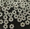 Tibetan Silver Daisy Flower Spacer 4mm x 1mm. Pack of 600